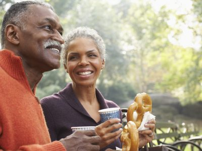 Couple with Coffee and Prezels in City Park, New York City, New York, USA